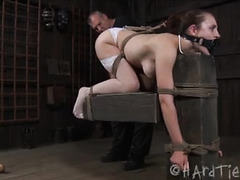 A skank with big, natural tits is tied up and tormented by her Master