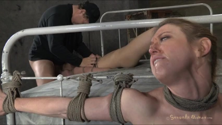 Two bound babes are made to watch each other get fucked hard @ goBDSM