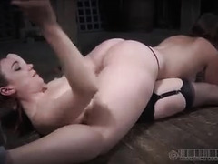 Two sexy slave girls are made to turn on each other during BDSM play