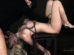 A blonde tramp is tied up and made to choke on her Master's cock