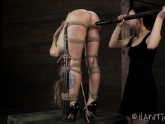 A tormented blonde is whipped, spanked and made to cum repeatedly