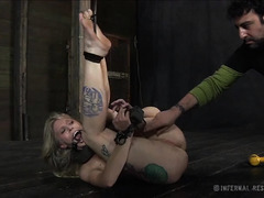 A tiny blonde is punished severely until she is screaming
