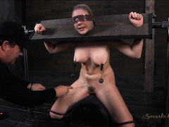 A trapped babe is put in the stocks for BJs and multiple orgasms
