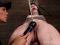 A black-haired punk girl has her ass reamed out by her Mistress