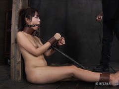 A small Asian hottie is brought to the edge through pleasure and pain
