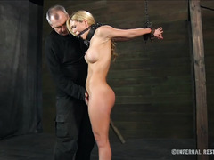 A sexy blonde moans beautifully while whipped and made to cum