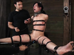 A miserable brunette is battered and bruised during punishment