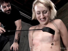 A pretty blonde's poor nipples are clamped, whipped and weighed down