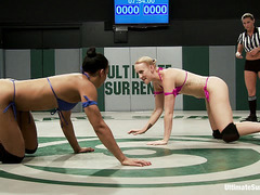 Hotties Dylan Ryan and Sophia Fiore flex their muscles in the ring