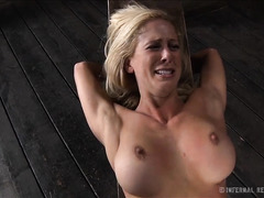 A busty blonde is commanded to fuck her pussy with a dildo