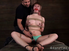 Ass and pussy toys are used to help this bound blonde orgasm