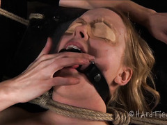 A squirming blonde is entwined by her devious and imaginative Mistress
