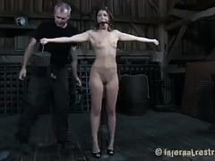 A new submissive gets her first taste of pain and punishment