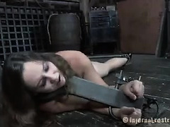 A brunette's whipping is made worse when her sight is taken away