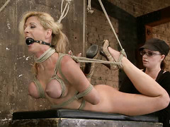 Cherie Deville endures uncomfortable bondage to please her Mistress