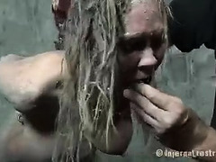 A big-boobed blonde is literally dragged through the mud and fucked