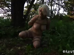 A slut hiking in the woods submits when captured like prey