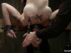 Tattooed redhead Tricia Oaks gets it good and hard from her Domme