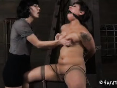A short-haired hottie moans as her soft, perky tits are abused