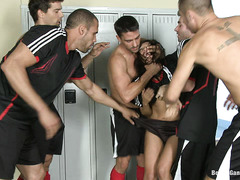 Curvy babe Vicki Chase is gangbanged in the locker room by the team