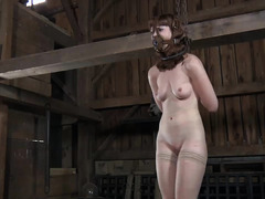 A pale-skinned redhead is brutally whipped and humiliated by her Dom