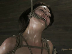 A caramel-skinned honey screams in overstimulation during BDSM fun