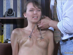 A Russian slave girl is covered in hot wax by her cruel, amused Master