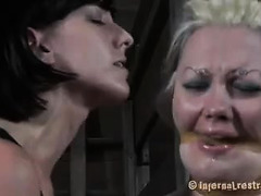A punk slut cries as she's tormented by an amused and critical Domme
