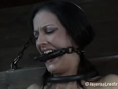 A skinny brunette is tied down and whipping until she cries out