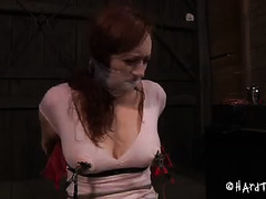 This beautiful redhead's giant tits are begging to be abused