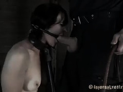 A pretty babe is tormented by Doms on two separate fronts
