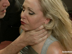 A red-hot MILF submits to a brutal and pleasurable BDSM fuck session