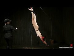 Fiery redhead Phoenix Askani shows off her flexibility and strength