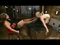 Sweet-faced blonde Penny Pax is dominated by two ruthless ladies