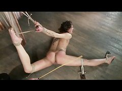 Flexible sub Bianca Stone twists and turns during her BDSM session