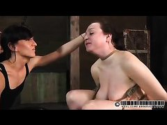 A busty broad is battered and bruised during a harsh punishment session