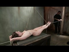 Missy Minks screams during intense predicament bondage and caning