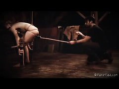 A pretty, gagged blonde whimpers during her BDSM punishment