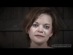 A short-haired sub is whipped and spanked until she bruises