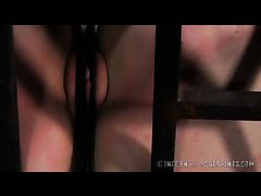 Dixon Mason is tormented in a cage by a sadistic Dom