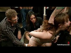 Fab redhead Bella Rossi is tied up and disgraced in public