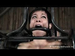 A short-haired chick gets caged and caned until she cries