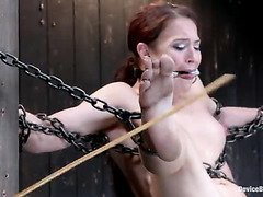 Chained Adriana Chechick enjoys her helplessness with a vibrator on her clit