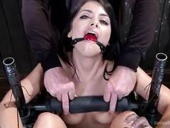 Sexy dark-haired beauty oozing with moist mess during punishment