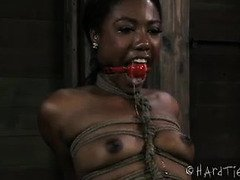 Stunning tied up ebony receives pleasurable punishment for her bald muff