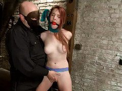 Sweet redhead endures punitive punishment from horny master
