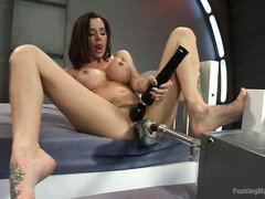 Two captivating chicks are easing their lusty needs with fuck machines
