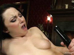Dark-haired beauty's bald muff is full of moist mess from playing with fuck machines