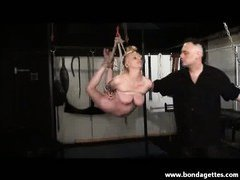 Blonde amateur subbie girl in rope suspension bondage