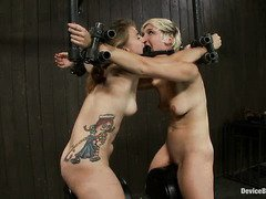 Two gorgeous beauties are bounded together as they ride on the sybian machines